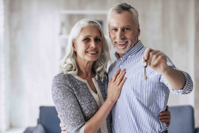 55+ Couple with Key to Home