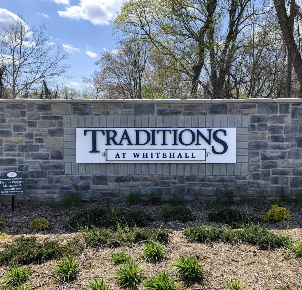 Traditions at Whitehall Entry Sign